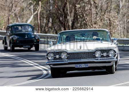 Adelaide, Australia - September 25, 2016: Vintage 1959 Oldsmobile Driving On Country Roads Near The