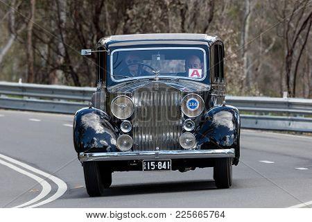 Adelaide, Australia - September 25, 2016: Vintage 1937 Rolls Royce 25/30 Saloon Driving On Country R
