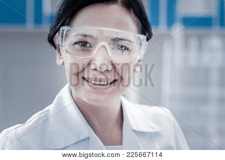 Do What I Love And Love What I Do. Portrait Of A Positive Minded Scientist Wearing Safety Glasses Po