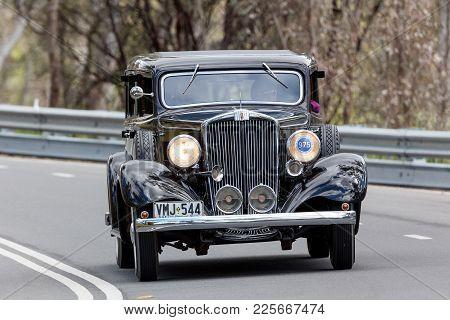 Adelaide, Australia - September 25, 2016: Vintage 1933 Hupmobile K Sedan Driving On Country Roads Ne