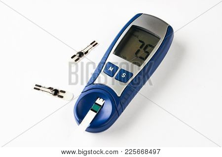 Diabetes, Glycemia, Medicine And Health Care Concept. Glucose Meter For Blood Sugar Test With Blood