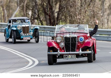 Adelaide, Australia - September 25, 2016: Vintage 1949 Mg Td Sports Roadster Driving On Country Road