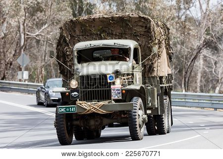 Adelaide, Australia - September 25, 2016: Vintage 1941 Gmc Cckw-353 Troop Carrier  Driving On Countr