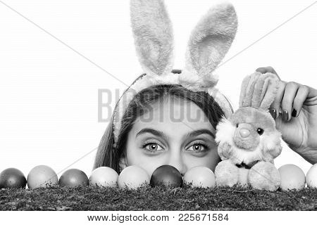 Happy Easter, Traditional Spring Holiday Celebration. Girl In Pink Bunny Ears With Colorful Painted