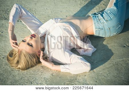 Sensual Woman With Sexy Belly, Fashion. Girl With Long Blond Hair Lie On Sunny Day, Beauty. Fashion,