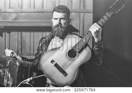 Frown Bearded Man With Beard Moustache And Gray Hair Stylish Hipster Male With Guitar Outdoors On Wo