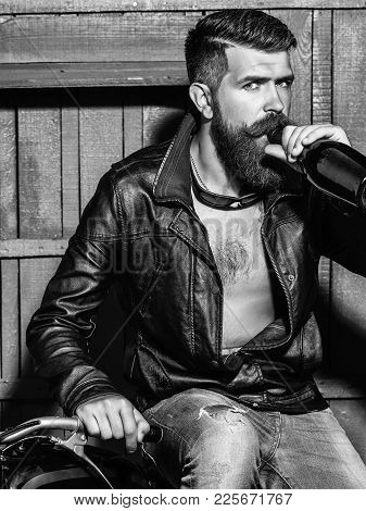 Bearded Man Hipster Biker With Beard And Moustache Handsome Stylish Male In Leather Jacket Drinks Fr