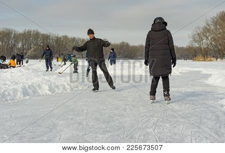 Dnipro, Ukraine - January 27, 2018: People In The City Use Frozen River Dnipro For To Go In Active R