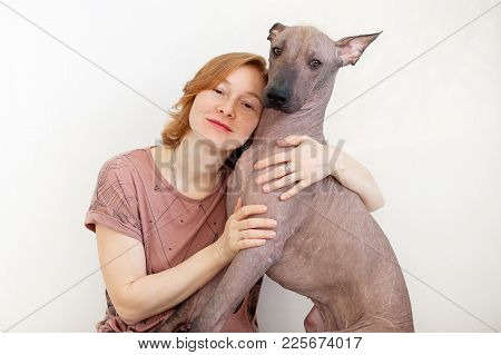 A Woman Hugging With A Mexican Hairless Dog On The White Background