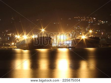 Oil Tankers In The Night Moored In The Port Of The Oil Mills Of Genoa Multedo Are Waiting To Resume