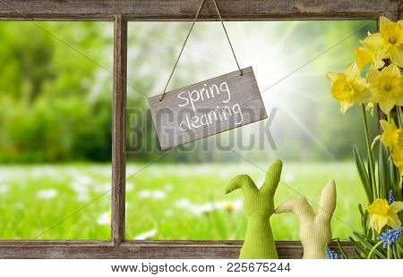 Sign With English Text Spring Cleaning. Window Frame With View To Beautiful Sunny Green Meadow. East
