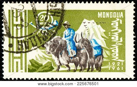 Ukraine - Circa 2018: A Postage Stamp Printed In Mongolia Show Post Rider On Yak Or Bos Grunniens. S
