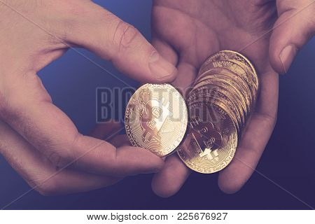 Cryptocurrency Concept With Closeup Of Caucasian Hands Counting A Pile Of Bitcoin Golden Coins