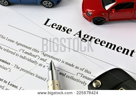 An Concept Image Of A Lease Agreement With Car And Key