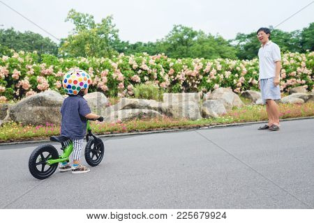 Young Father Spend Time With Cute Little Asian 18 Months / 1 Year Old Toddler Boy Child, Dad And Son