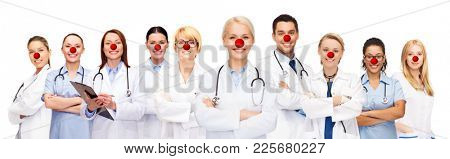 medicine, red nose day and healthcare concept - international group of smiling medics or doctors over white background