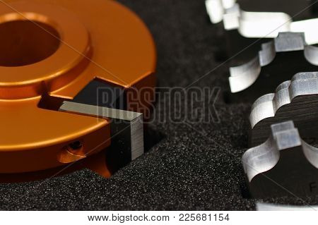 Shaper Cutter Head And Knives For Spindle Moulder Machine. Woodworking Industry Close Up Image With