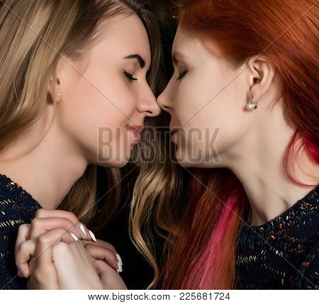 Girlfriends Spend Time Together. Two Pretty Lesbians Girlfriends Kissing And Hugging In A Cozy Atmos