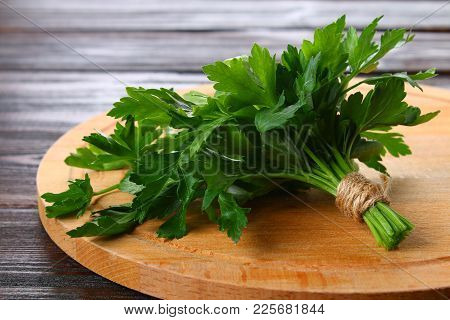 Fresh Green Parsley On The Wooden Table, Selective Focus