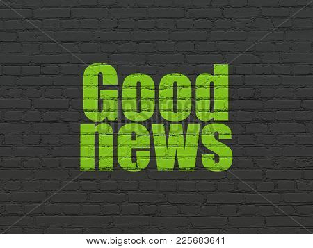 News Concept: Painted Green Text Good News On Black Brick Wall Background