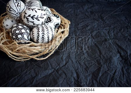 Easter Eggs With The Hand-drawn Different Doodle Patterns In Decorative Nest On A Black Background.
