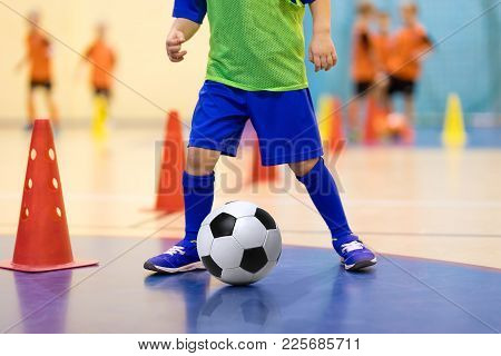 Football Futsal Training For Children. Soccer Training Dribbling Cone Drill. Indoor Soccer Young Pla