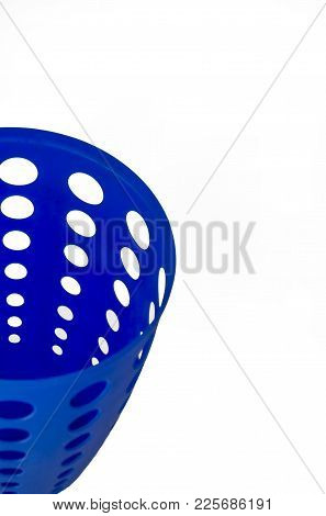Empty Moderrn Blue Plastic Trash Can With Holes Isolated In White Background