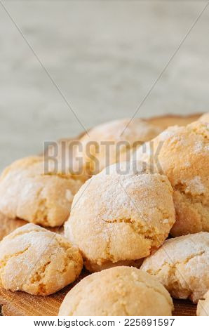 Homemade Amaretti Cookies On A Wooden Board On A White Stone Backdrop.