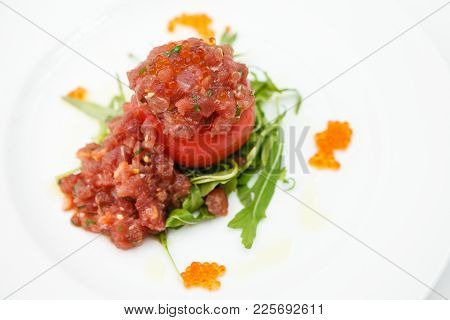 Tuna Tartar With Tomato, Rucola Salad And Red Caviar