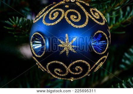 Macro Shot Of A Blue Ball Shaped Ornament On A Christmas Tree