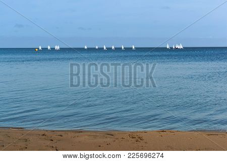 Racing Yachts With White Sails, Centerboarder Yachts In The Distance On The Water