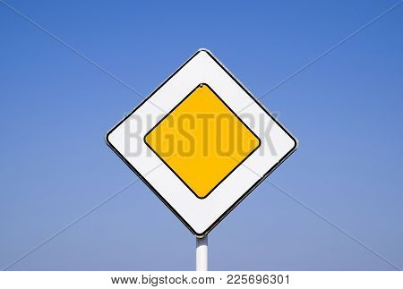 Road Signs, The Main Road. Sign On A Blue Background.