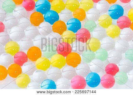 Balls Of A Colored Polymer Gel On A White Background, Balls Of A Hydrogel. Close-up.
