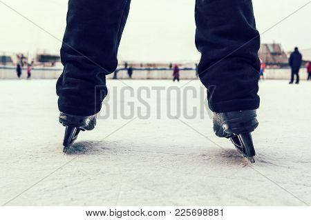 Legs Of Skater In Motion At Skating Rink