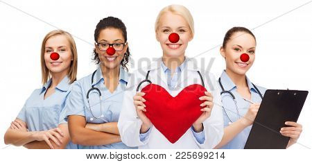 medicine, red nose day and healthcare concept - international group of smiling medics or doctors with heart over white background