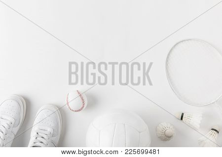 View Of Various Sports Equipment On White Surface