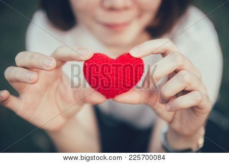 Love And Heart Red Color On Women Hand In Valentine's Day Vintage Color Tone