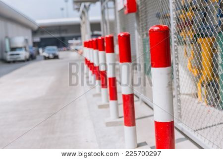 Non Parking Space Or Danger Space Of Gas Storage Area Do Not Approach Red-white Stripes Pole.