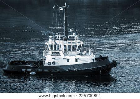 Corsica, France - July 2, 2015: Persevero Tug Boat Underway On Sea Water. Porto Vecchio Bay. Blue To