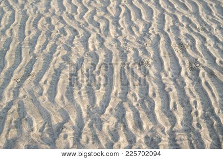 Lifeless Marsiasky Landscape With Stones And Furrows On The Surface Of Soil