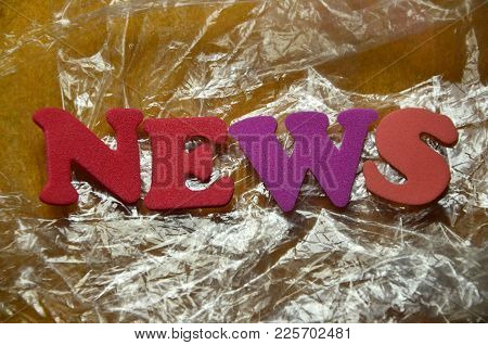 Word News On An   Abstract Colorewd Background