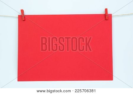Hanging Greeting Card Isolated On White Background. Red Paper Card Hanging On The Rope Fixed By Two