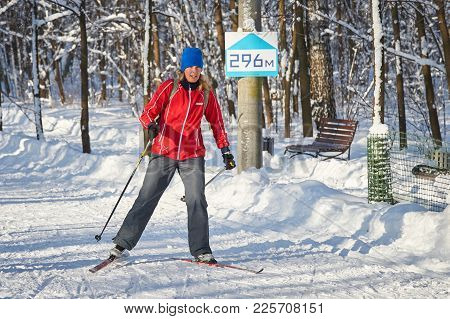 Moscow, Feb. 01, 2018: Skate Skiing Woman In City Forest Park Sokolniki At Sunny Winter Day. Winter
