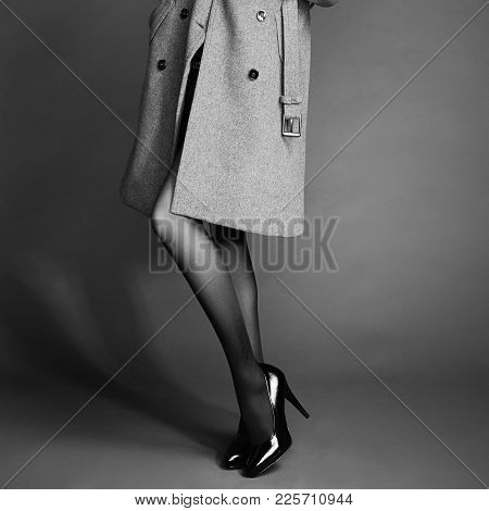 Young Woman In Coat With Beautiful Feet. Beautiful Long Legs. Autumn Coats And Shoes. Girl In Stocki