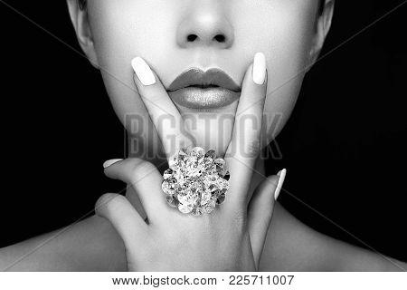 Beauty Fashion Woman Lips With Natural Makeup And White Nail Polish. Gloss Lipstick. Beauty Girl Fac