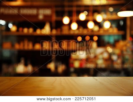 Top Of Nature Wood With Blur Bokeh Lamp Light Bar Or Club Cafe Background