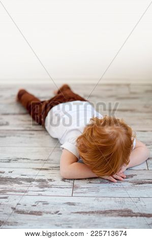 The Boy Is Lying On The Floor, Belly Down