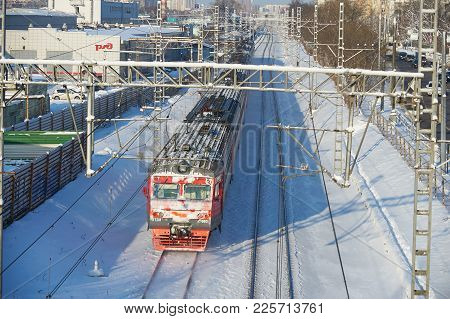 Moscow, Feb. 01, 2018: Winter View On Russian Railways Red Snow Covered Passenger Train In Motion On