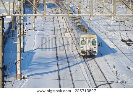 Moscow, Feb. 01, 2018: Winter Day View On Russian Railway Passenger Train In Motion. Snow Covered Ra