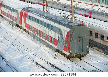 Moscow, Feb. 01, 2018: Diagonal Winter View On Russian Railway Passenger Train With Double Deck Coac